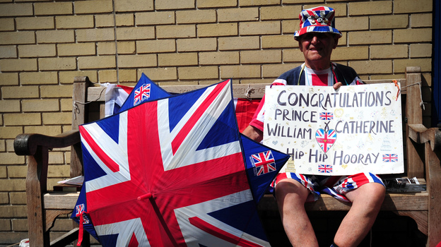 Royal well-wisher Terry Hutt poses for a picture as he waits outside the Lindo Wing of Saint Mary's Hospital in London on Friday. (AFP/Getty Images)