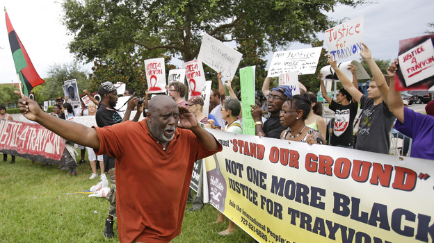 Chimurenqa Waller leads demonstrators in a chant in front of the Seminole County Courthouse while the jury deliberated in the trial of George Zimmerman on Friday (AP)