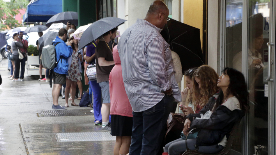 Hopeful customers line up outside New York's Dominique Ansel Bakery to purchase cronuts. (AP)