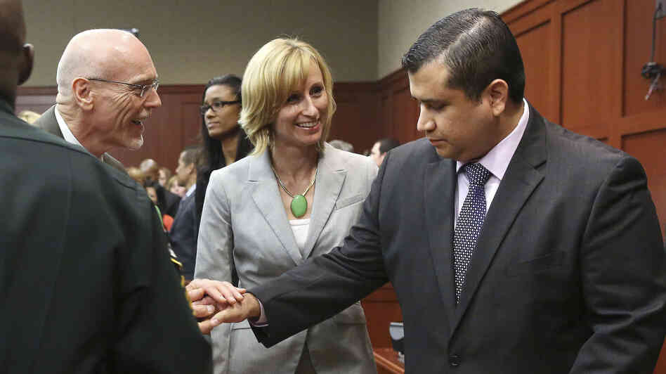 George Zimmerman, right, is congratulated by his defense team after being found not guilty of all charges in Seminole Circuit Court in Sanford, Fla., on Saturday.