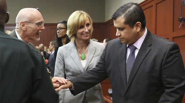 George Zimmerman, right, is congratulated by his defense team after being found not guilty of all charges in Seminole Circuit Court in Sanford, Fla., on Saturday. (AP)