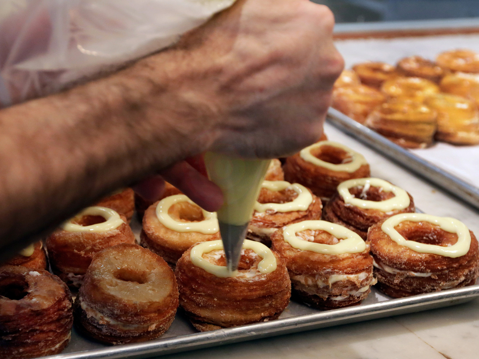 Chef Dominique Ansel makes cronuts, a croissant-donut hybrid, at his New York bakery in June.