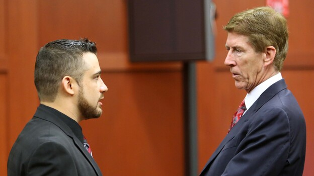 Robert Zimmerman Jr. (left) speaking with defense attorney Mark O'Mara during a pre-trial hearing in May. (Getty Images)