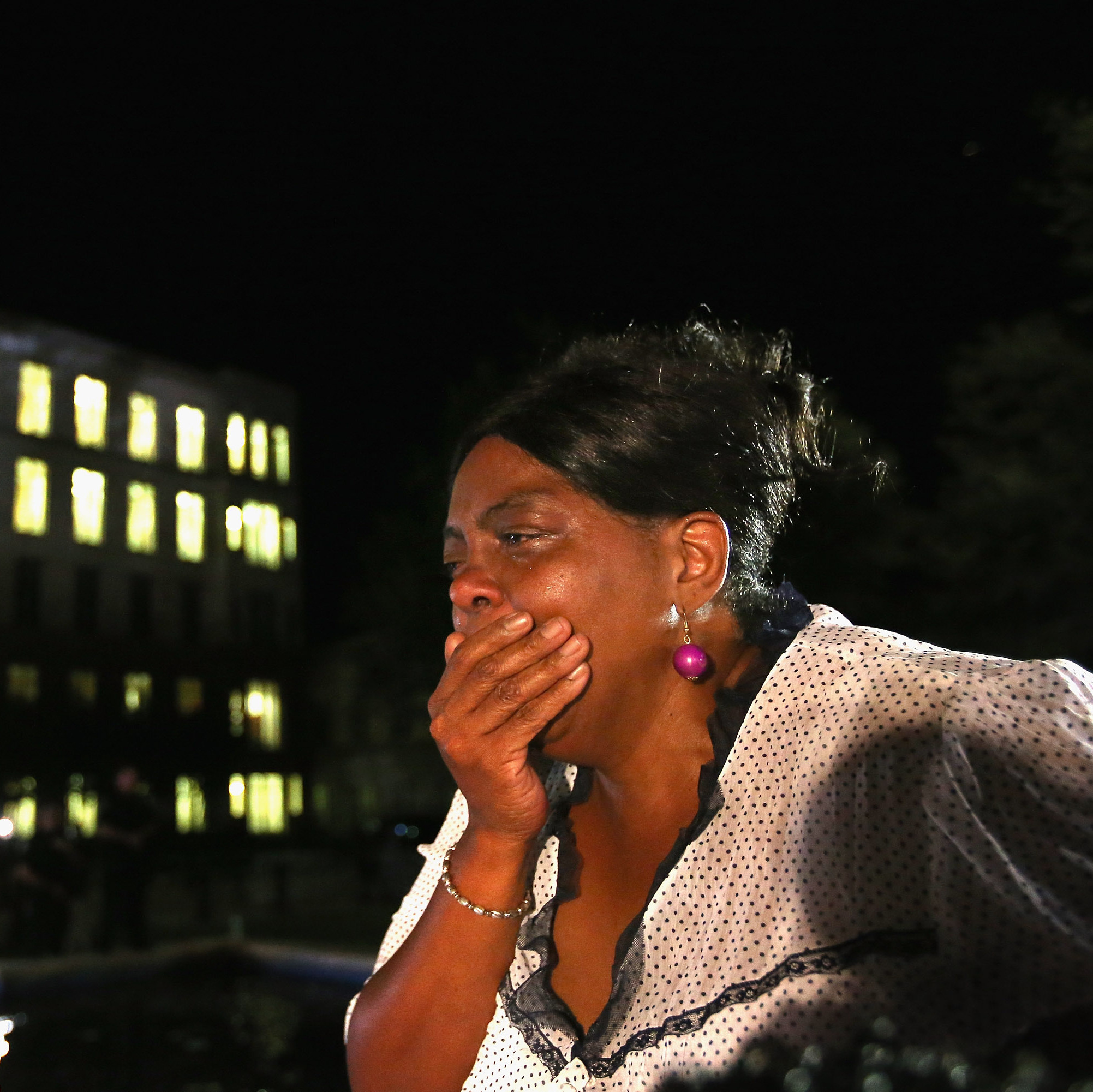 A stunned Carmen Taylor bursts into tears in front of the Seminole County Criminal Justice Center after learning George Zimmerman had been found not guilty late Saturday.