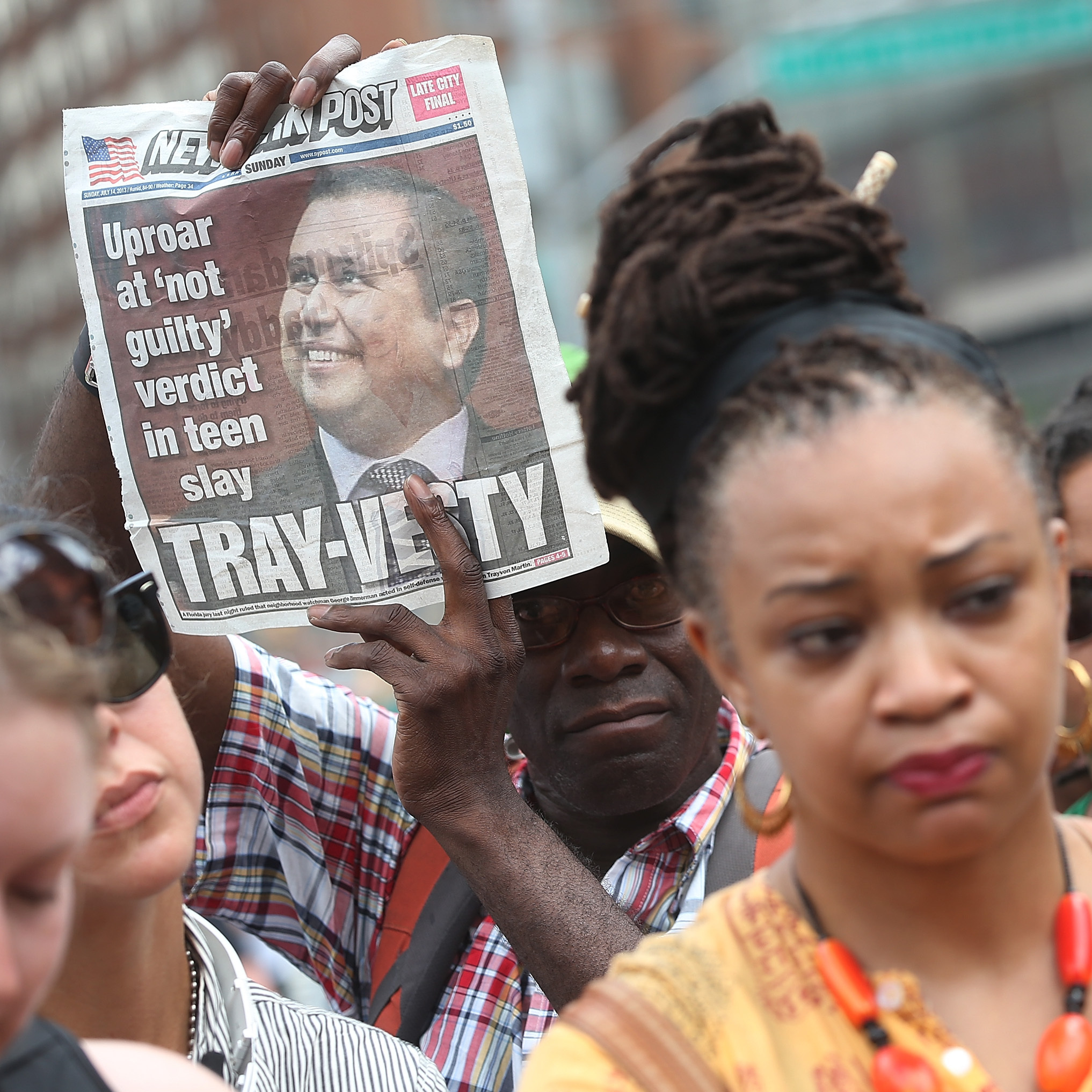 People gather at a rally honoring Trayvon Martin at Union Square in New York City on Sunday. On Saturday, a jury in Sanford, Fla., acquitted George Zimmerman of all charges in the shooting death of Martin. Rallies were held in several U.S. cities on Sunday denouncing the verdict.
