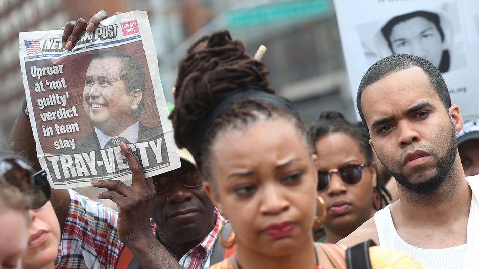 People gather at a rally honoring Trayvon Martin at Union Square in New York City on Sunday. On Saturday, a jury in Sanford, Fla., acquitted George Zimmerman of all charges in the shooting death of Martin. Rallies were held in several U.S. cities on Sunday denouncing the verdict.  (Getty Images)