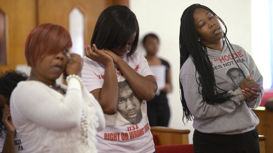 Tammy Haynes, left, Whitney Tillman, center, and Crystal Haynes attend a sermon at the St. Paul Missionary Baptist Church in Sanford, Fla., Sunday. Many in the congregation wore shirts in support of Trayvon Martin. (AP)