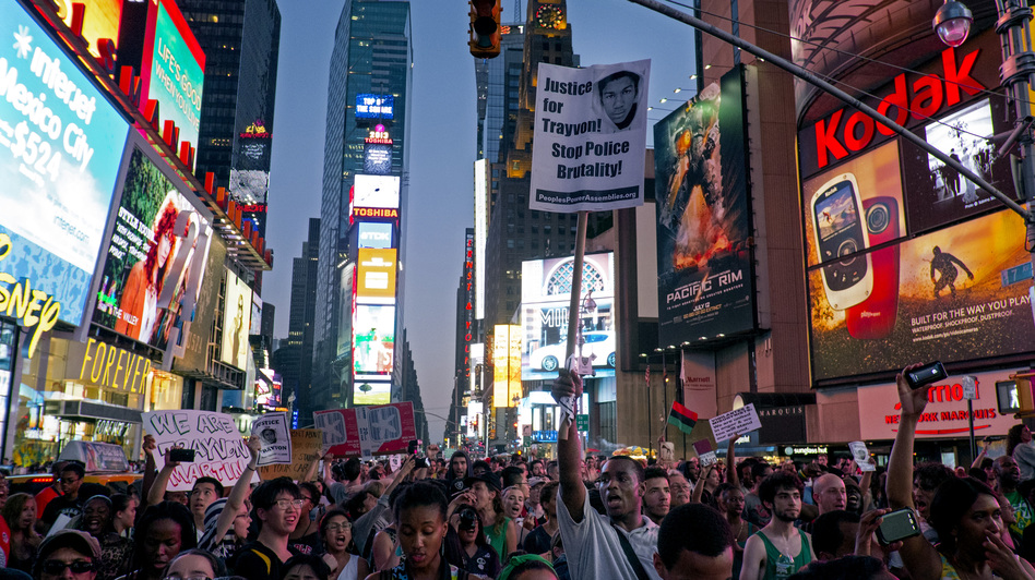 Marchers in New York's Times Square Sunday protest the acquittal of George Zimmerman in the killing of 17-year-old Trayvon Martin in Sanford, Fla. (AP)
