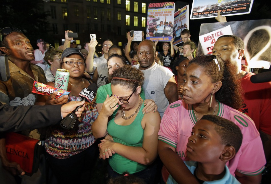 Demonstrators gathered outside the courthouse on Saturday to hear the jury's decision in the case of the shooting of the 17-year-old. (AP)