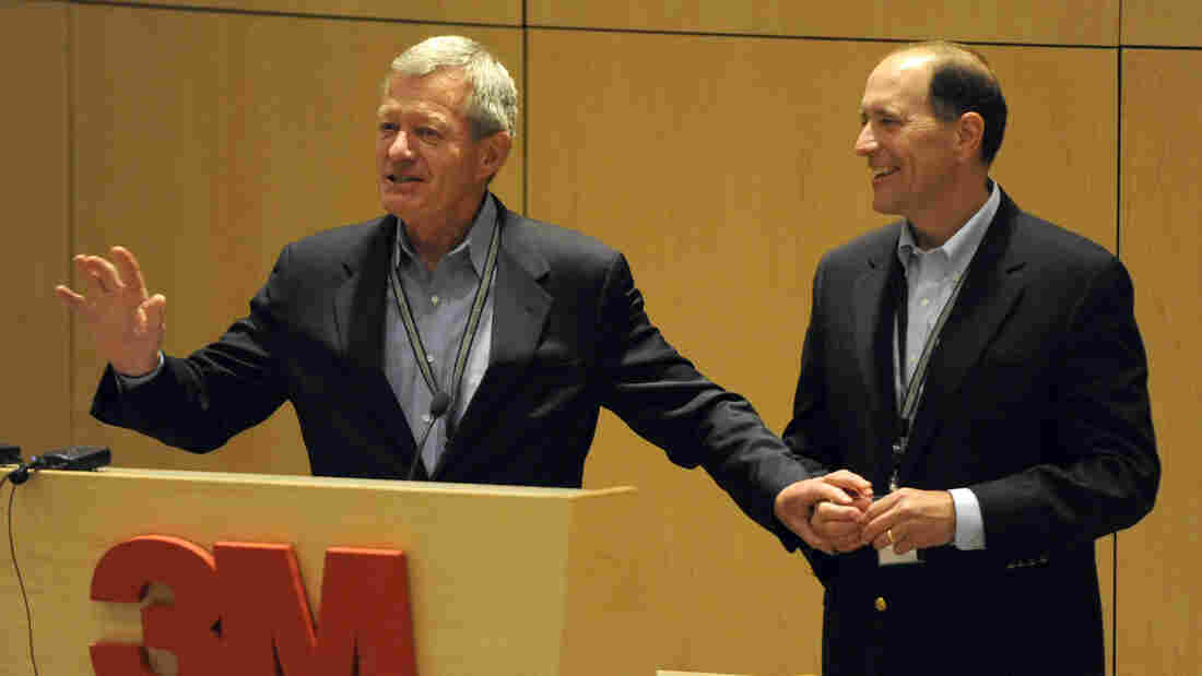 Sen. Max Baucus, D-Mont. left, and Rep. Dave Camp, R-Mich., speak about overhauling tax policy to an audience at the 3M tech company on Monday.