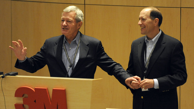 Sen. Max Baucus, D-Mont. left, and Rep. Dave Camp, R-Mich., speak about overhauling tax policy to an audience at the 3M tech company on Monday. (AP)