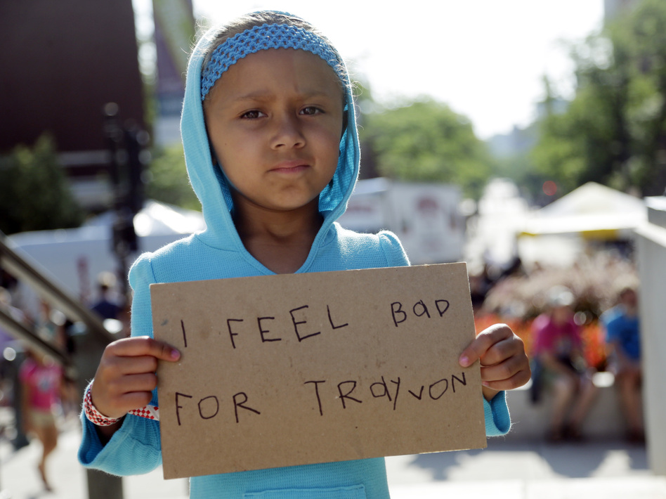 Tatum Stoball, 5, of Madison, Wis., holds up a sign during a protest of the acquittal of George Zimmerman on Sunday in Madison, Wis. (AP)