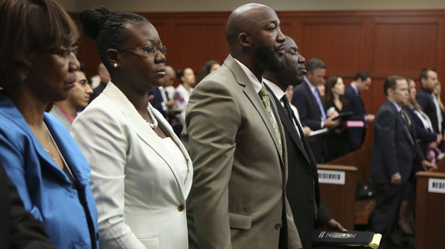 Many families live in dread of standing in the shoes of Trayvon Martin's parents. His mother, Sybrina Fulton (second from left) and father, Tracy Martin, were in court Friday as a Florida jury began its deliberations. (AP)
