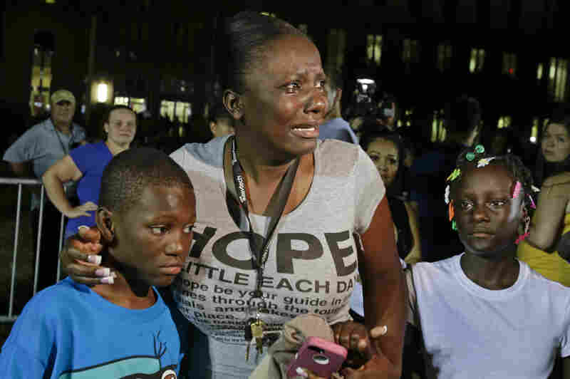 Saturday night, Darrsie Jackson keeps her children — Linzey Stafford, left, 10, and Shauntina Stafford, 11 — close after hearing the not-guilty verdict in the trial of George Zimmerman outside the Seminole County Courthouse in Sanford.