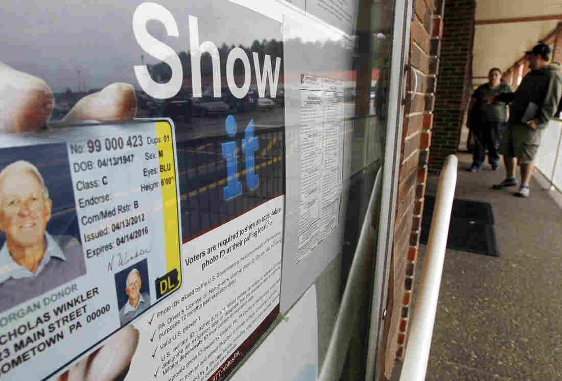 The Penndot Drivers License Center in Butler, Pa., displays signs promoting the requirement for voters to show an acceptable photo ID at the polls. On Monday, a judge will rule on the constitutionality of the state's controversial voter ID law.