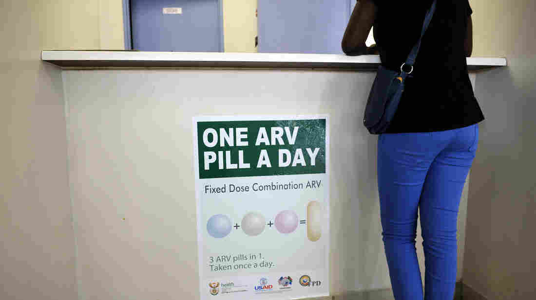 A woman waits to get AIDS drugs on April 8 at a clinic in Ga-Rankuwa, South Africa, about 55 miles north of Johannesburg. New WHO guidelines say patients should start HIV treatment much earlier, before they become extremely sick.