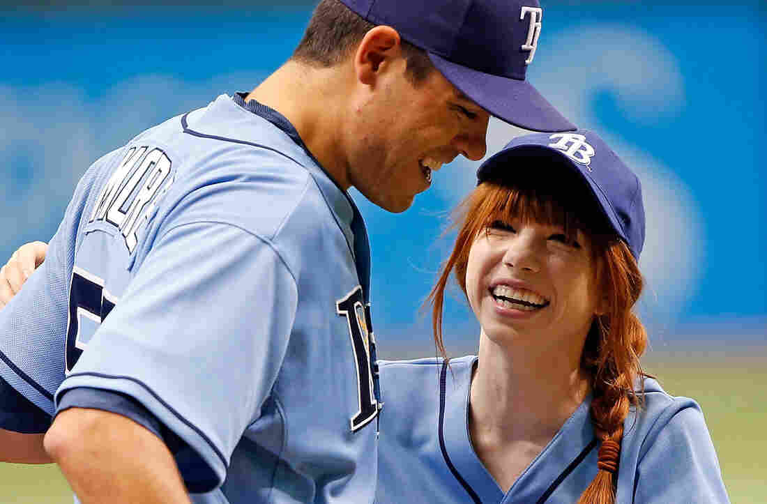 Singer Carly Rae Jepsen smiles with pitcher Matt Moore just before the start of the game between the Tampa Bay Rays and the Houston Astros on Sunday at Tropicana Field in St. Petersburg, Fla.