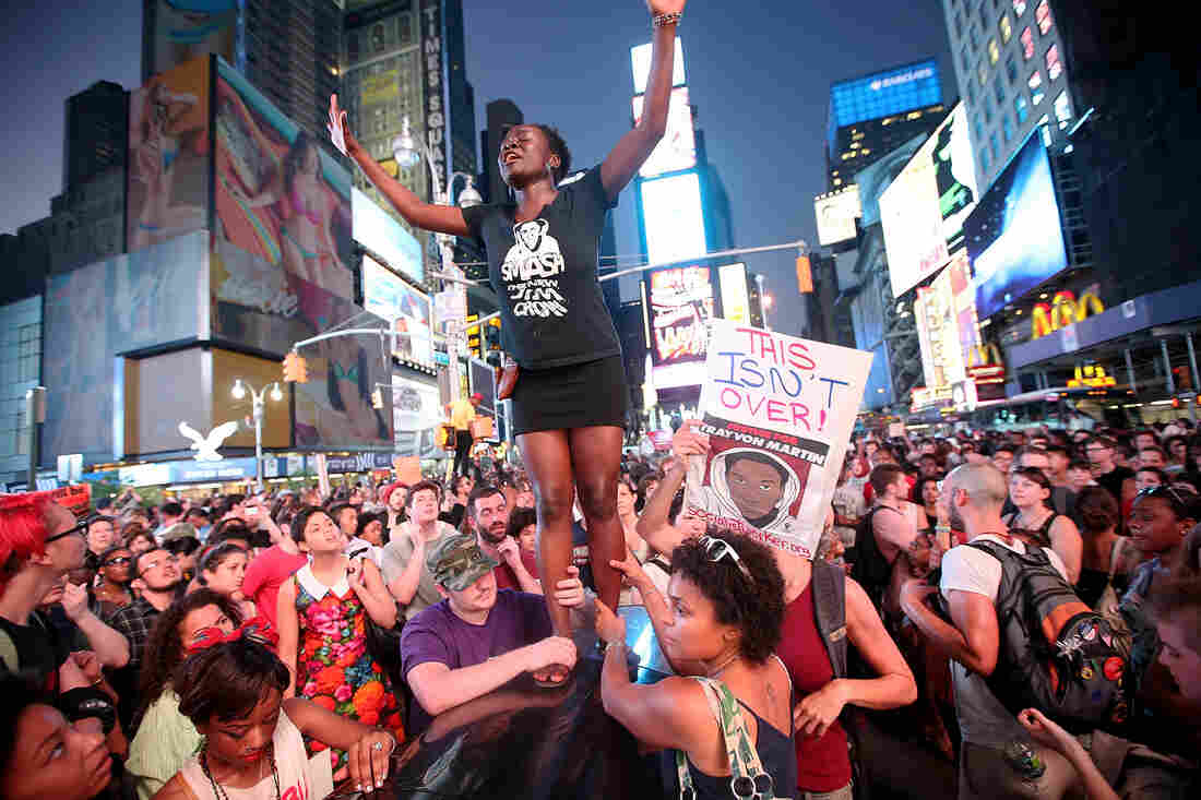 Trayvon Martin supporters rally in New York's Times Square on Sunday.