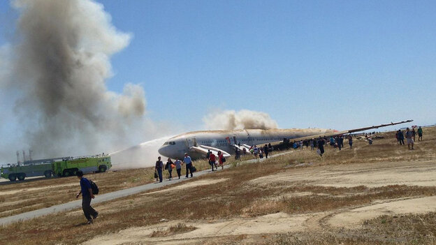 Passengers move away from the wreckage of Asiana Airlines Flight 214 after the plane's July 6 crash-landing in San Francisco. This photo was taken by a passenger.
