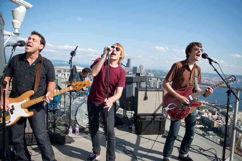Touch Me I'm A Local Institution: Mudhoney plays from more than 500 feet above Seattle, on the roof of the Space Needle, as part of a set celebrating Sub Pop's Silver Jubilee broadcast by KEXP