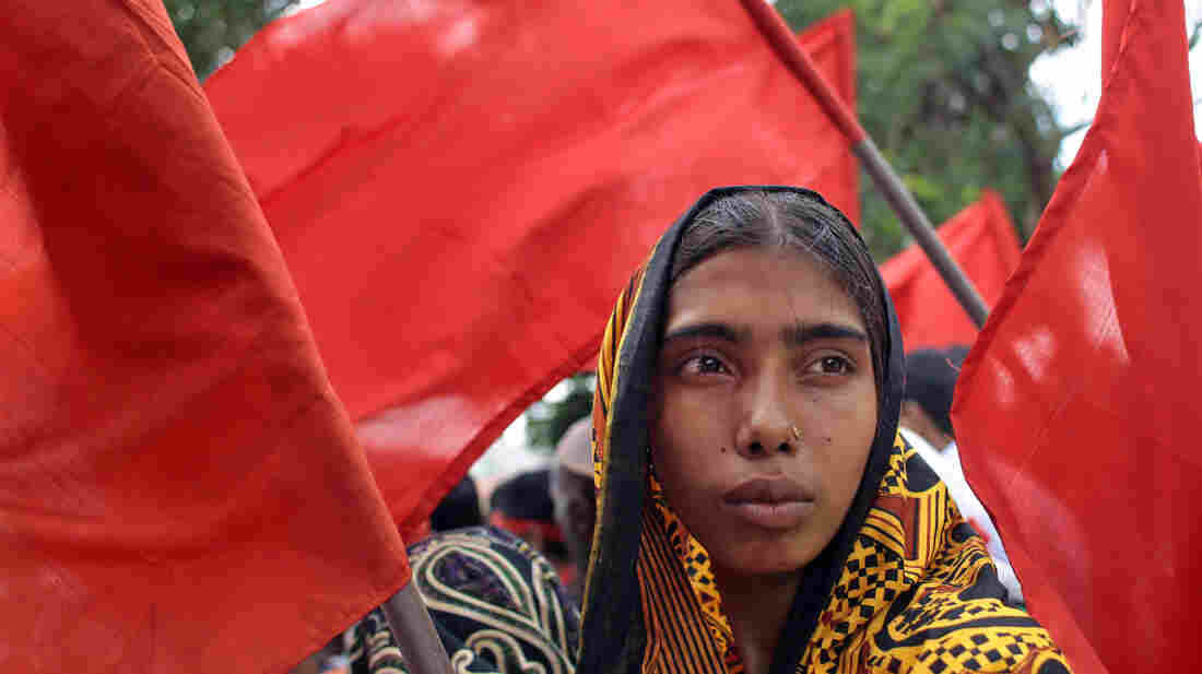 A Bangladeshi garment worker participates in a protest outside the Bangladesh Garment Manufacturers and Export Association office building in the capital, Dhaka, on July 11. The country's Parliament approved a new law that would allow workers to unionize more freely.
