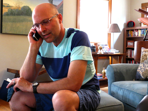 Brian Mathers calls his husband, Isidro, in Mexico from his living room in Sioux City, Iowa. Brian and Isidro have been separated for more than a year by immigration laws that did not recognize their marriage.
