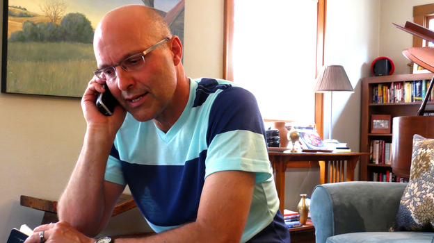 Brian Mathers calls his husband, Isidro, in Mexico from his living room in Sioux City, Iowa. Brian and Isidro have been separated for more than a year by immigration laws that did not recognize their marriage. (NPR)