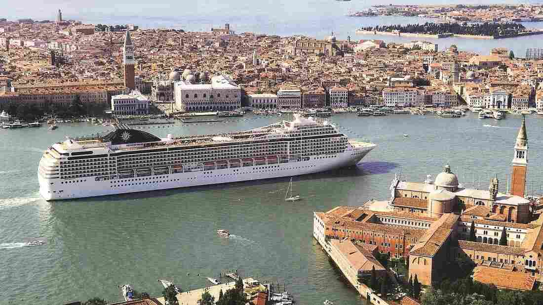 A cruise ship in Venice sails by St. Mark's Square and Doge's Palace.