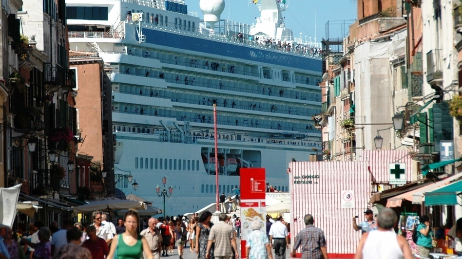 A massive cruise ships towers over Venice. Some 650 cruise ships now visit the Italian city annually, and critics say they threaten the city's fragile architecture. (Courtesty of the No Big Ships Committee)