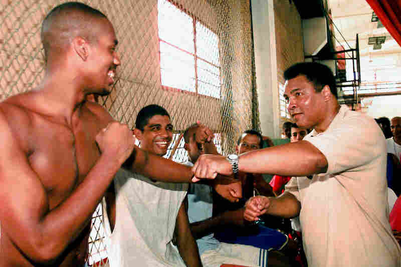 Ali spars with a Cuban amateur boxer on Sept. 10, 1998, during his visit to the Cerro Pelado sport complex in Havana. Ali was on a three-day visit to Cuba to deliver a $1.2 million donation in humanitarian aid to local hospitals.