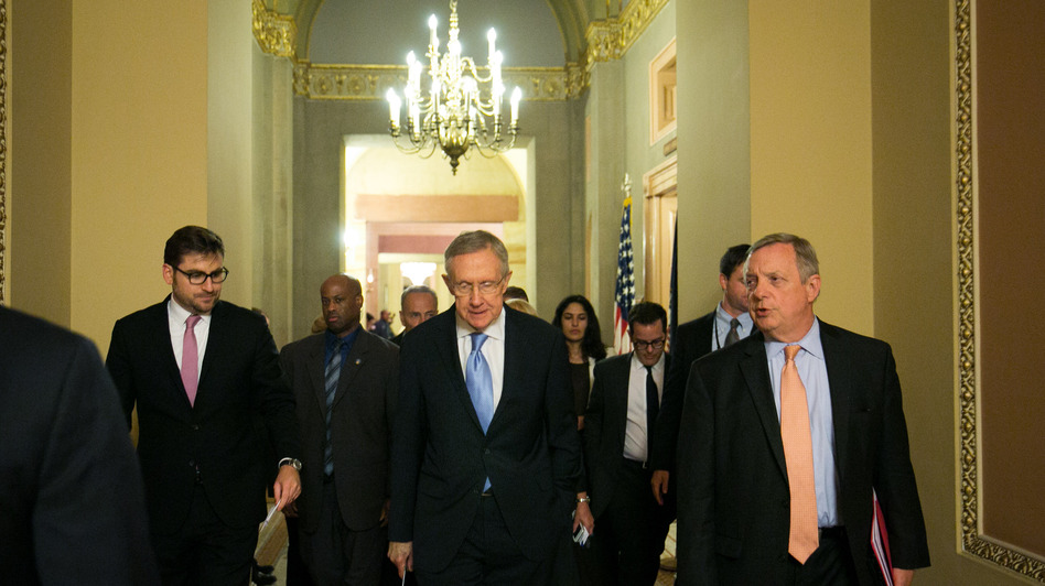 Senate Majority Leader Harry Reid walks with Sen. Dick Durbin of Illinois (right) after a joint caucus meeting on Monday. (Getty Images)