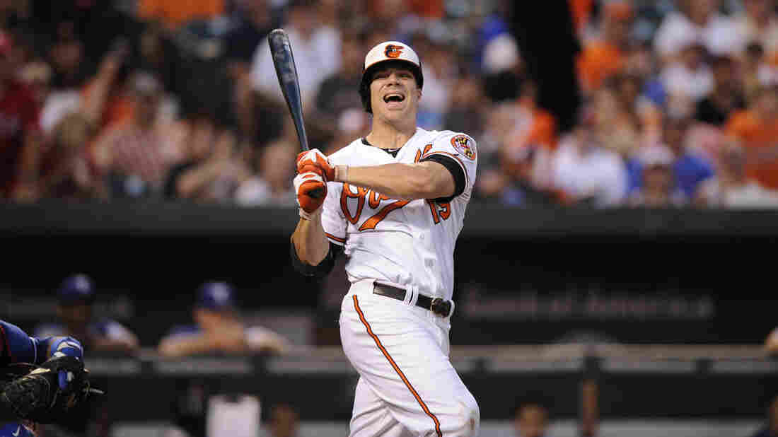 Chris Davis of the Baltimore Orioles reacts during a fourth-inning at-bat against the Texas Rangers on July 8.