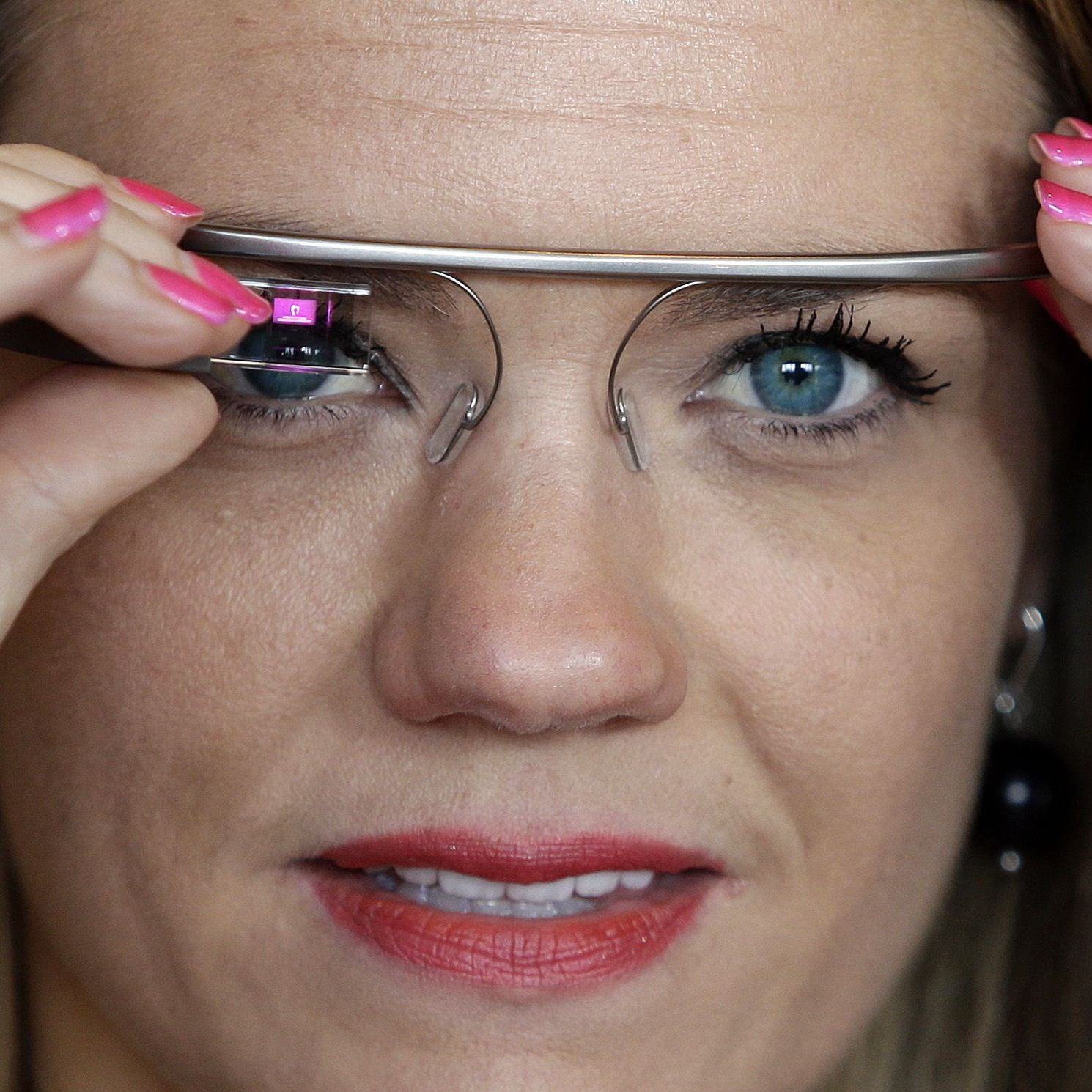 Sarah Hill, a Google Glass explorer, tries out her device in May.