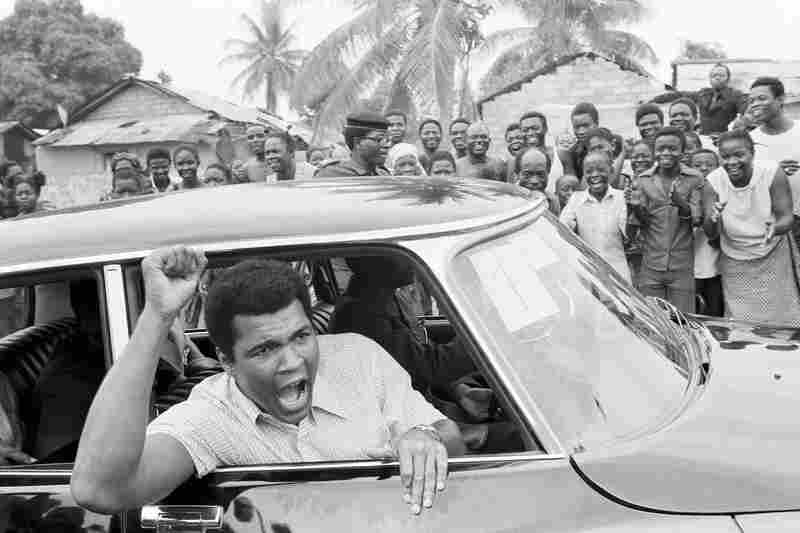 "Ali tours downtown Kinshasa on Sept. 17, 1974, ahead of his fight with Foreman. The bout was famously hyped as the ""Rumble in the Jungle."""