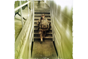 A soldier walks toward the departures lounge at Kandahar Air Field before making the long journey home back to the United States. Soldiers and Marines leaving Afghanistan this year probably won't be going back.