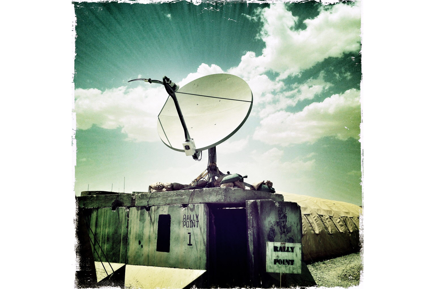 A communications satellite outside the living quarters for the soldiers based in the horn of Panjwai. The men have access to the Internet and can make regular telephone calls home, which can be both painful and helpful.