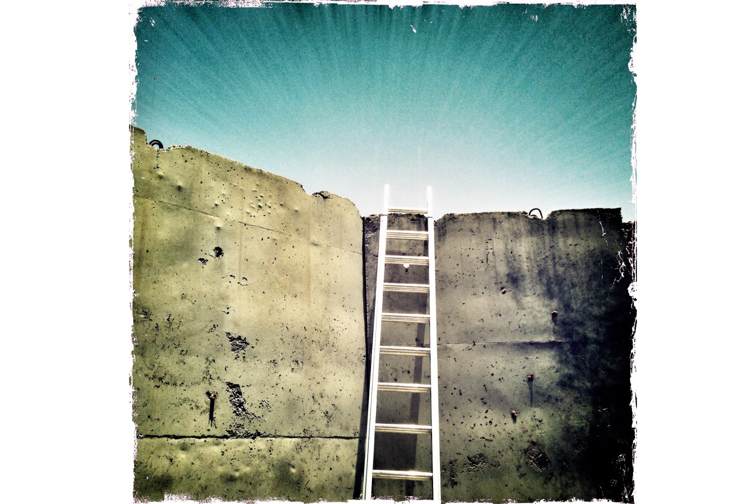 A ladder rests against a T-barrier wall on the inner perimeter of a combat outpost in eastern Afghanistan.