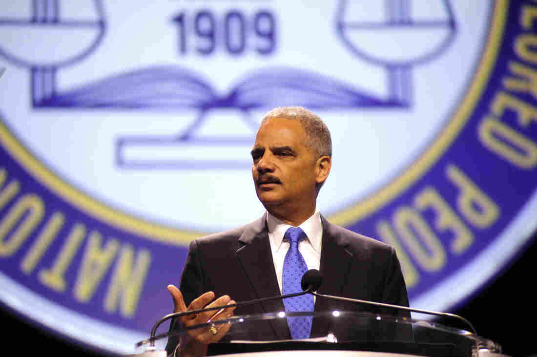 """Attorney General Eric Holder speaks at the annual convention of the NAACP in Orlando, Fla., on Tuesday. Holder told the convention that """"Stand Your Ground"""" laws that have been adopted in 30 states should be reconsidered."""