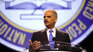 "Attorney General Eric Holder speaks at the annual convention of the NAACP in Orlando, Fla., on Tuesday. Holder told the convention that ""Stand Your Ground"" laws that have been adopted in 30 states should be reconsidered."