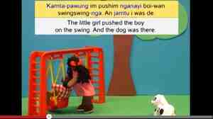 """A screen image from a video that professor Carmel O'Shannessy has created. In it, a girl tells a story in """"Light Warlpiri,"""" the language O'Shannessy reports she discovered in Australia."""