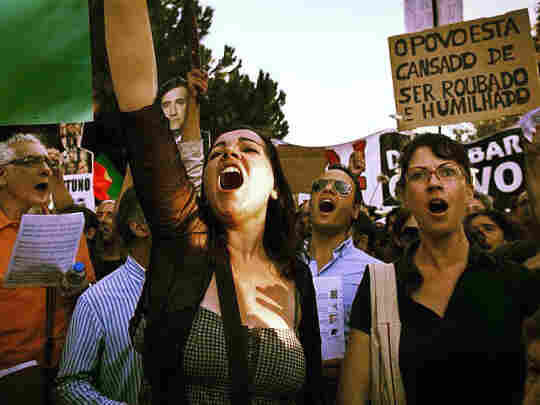 """Pinto leads protesters in song during anti-austerity demonstrations. """"I'm just a normal citizen,"""" she says. """"I just have this stron"""