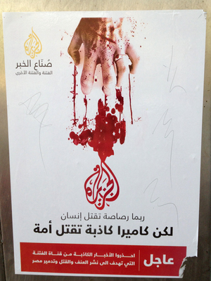 Posters in Cairo show Al-Jazeera's logo in red with a bloody hand scratching at it. A bullet can kill a man, the poster says, but a lying camera can kill a nation.