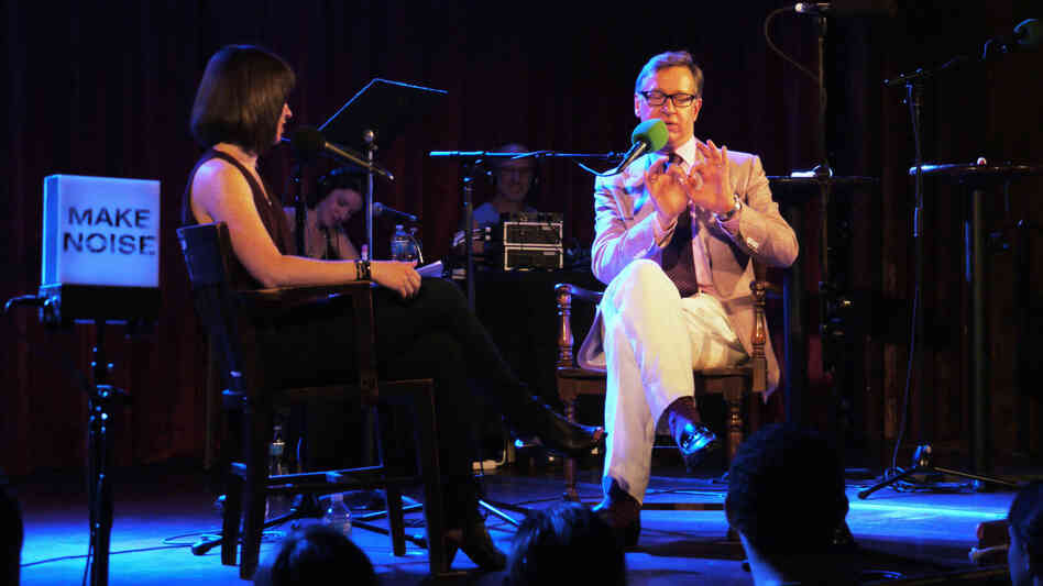 Director Paul Feig (The Heat, Bridesmaids, Freaks and Geeks) pantomimes one of his childhood magic tricks, on Ask Me Another stage.