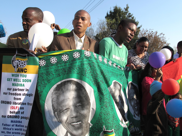Supporters of Nelson Mandela rally outside the Mediclinic Heart Hospital in Pretoria, South Africa, where he has been treated for more than a month. The anti-apartheid icon turned 95 on Thursday. (NPR)