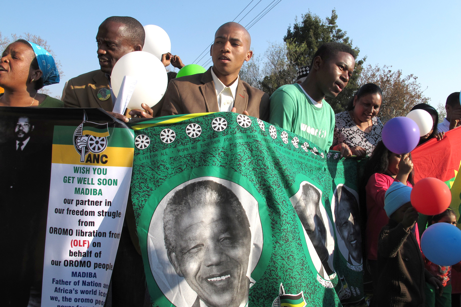 Supporters of Nelson Mandela rally outside the Mediclinic Heart Hospital in Pretoria, South Africa, where he has been treated for more than a month. The anti-apartheid icon turned 95 on Thursday.