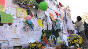 Well-wishers leave flowers, stuffed animals, posters, cards and balloons outside the entrance to the Mediclinic Heart Hospital.
