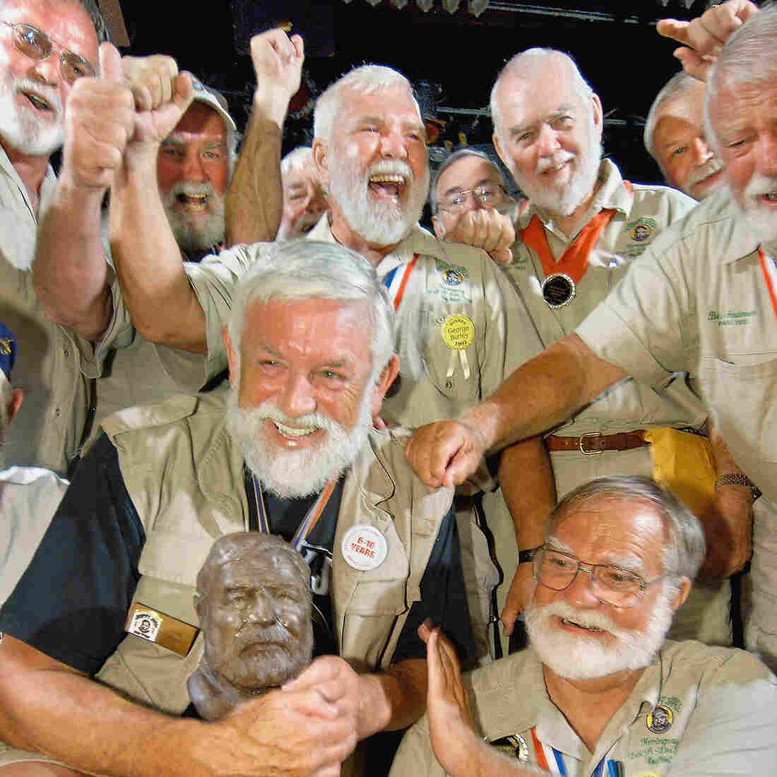"John Stubbings (front left) of North Carolina receives congratulations after winning the 2004 ""Papa"" Ernest Hemingway Look-Alike Contest at Sloppy Joe's Bar in Key West, Fla."