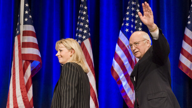 Liz Cheney walks off the stage with her father, former Vice President Dick Cheney, after addressing the Conservative Political Action Conference in 2010.