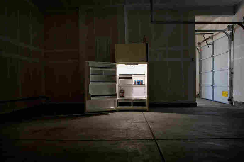 The remnants of food linger in the three-car garage of a large foreclosed home.