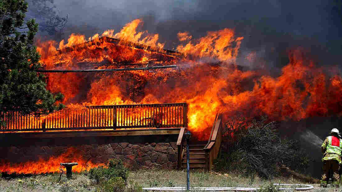 Fire consumed a home in Estes Park, Colo., on June 23, 2012. This fire claimed as many as 21 structures.